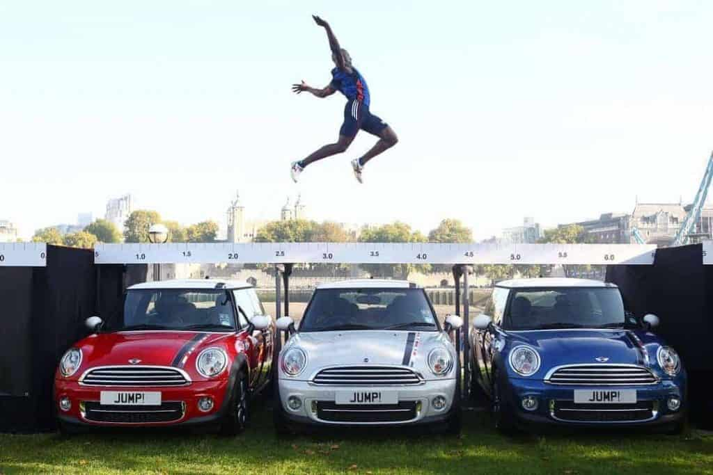 Athlete over achieving by jumping over Minis