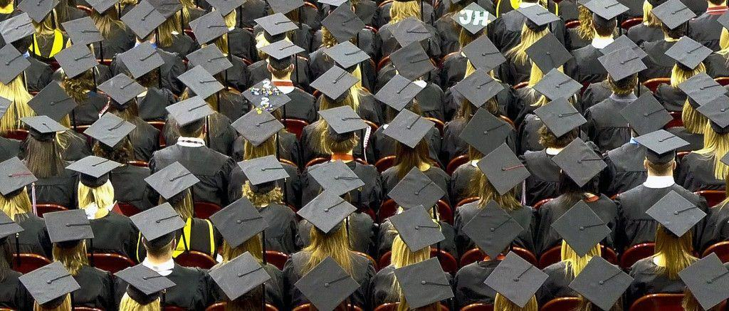 Students graduating with a college degree