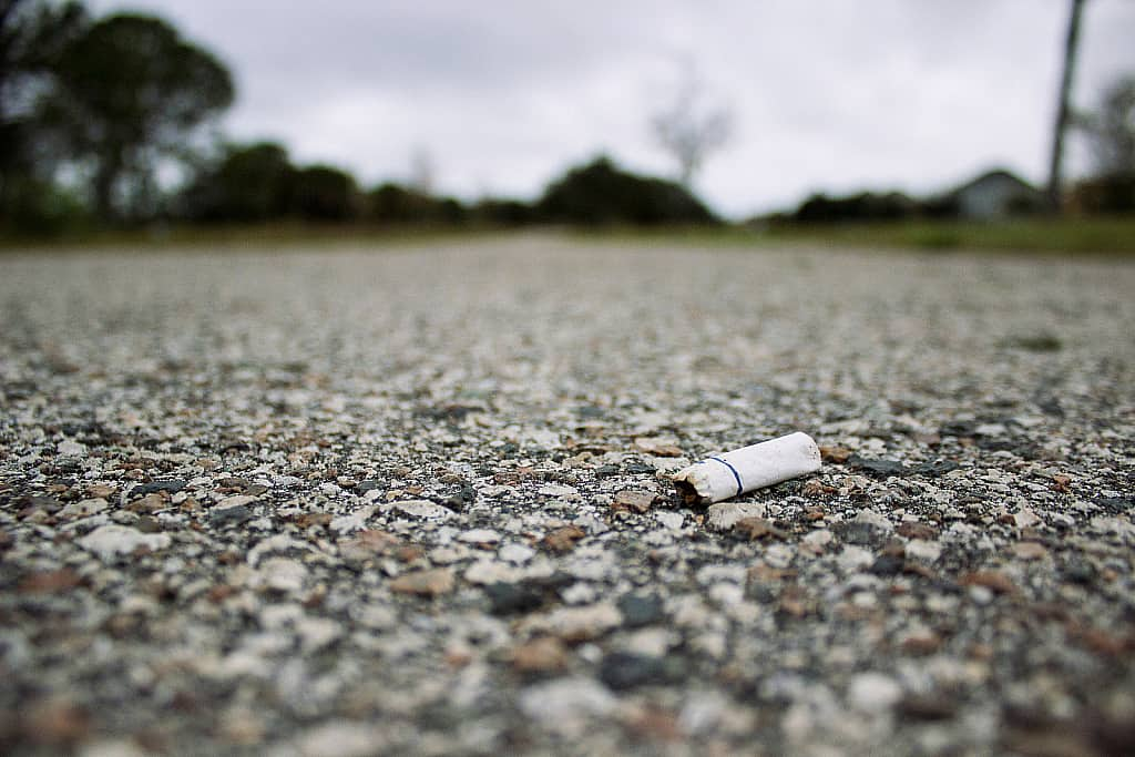 Cigarette butt left behind on road